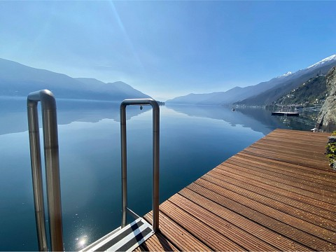SOLD !!!  Wake up directly at the lake - Cosy studio apartment with own sauna, terrace and pergola